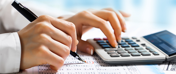 Expert doing calculations as part of accounting services